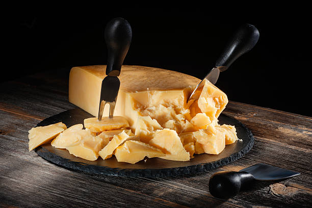 Cтоковое фото Cheese parmesan with a set of knives on  round slate