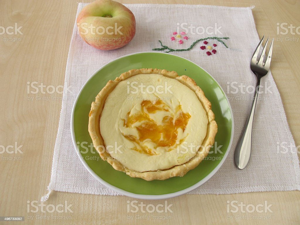 Cheese peach tart on a plate stock photo