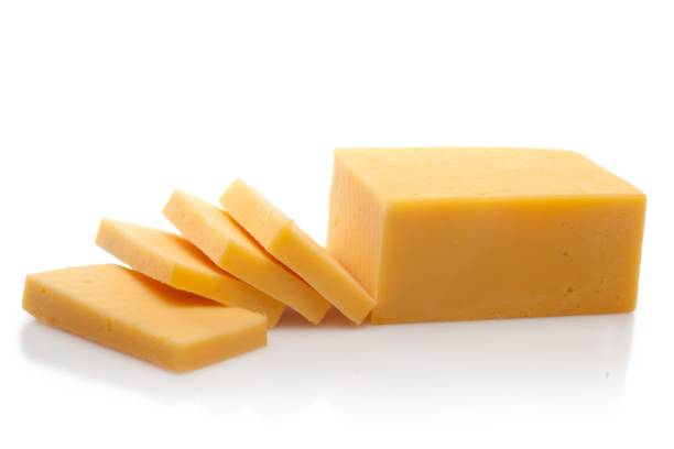Cheese. Piece and Sliced of Cheddar Cheese cheddar cheese stock pictures, royalty-free photos & images