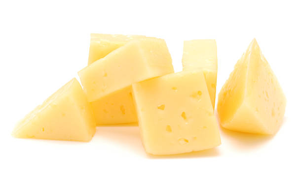 cheese pieces of cheese isolated on white cheddar cheese stock pictures, royalty-free photos & images