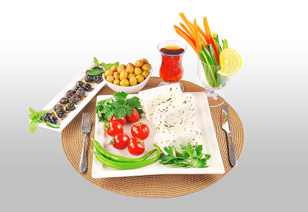 Cheese Cheese, cheese plate, tomato, isolated cheese, vegatable, olive, black olives, green olives, lemon, tea, isolated plate, parsley grafiker stock pictures, royalty-free photos & images