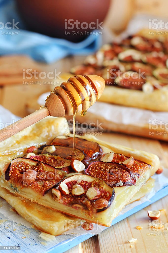 cheese pie with figs, nuts and honey stock photo