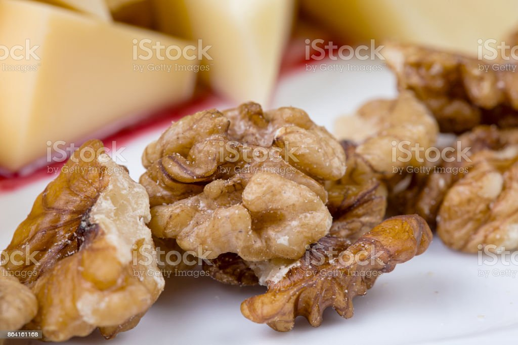 Cheese pieces with walnuts royalty-free stock photo