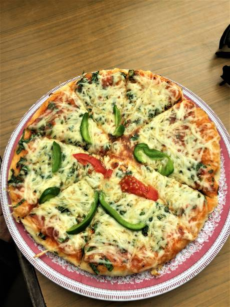 Cheese Pizza topped with peppers stock photo