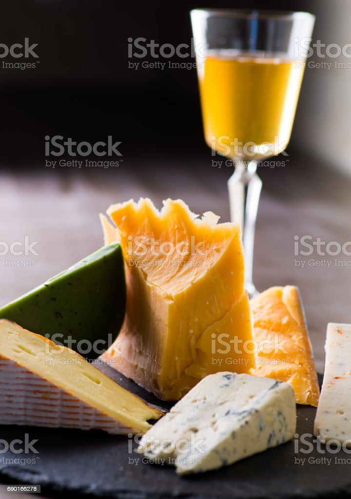 Cheese plate and a glass of wine stock photo