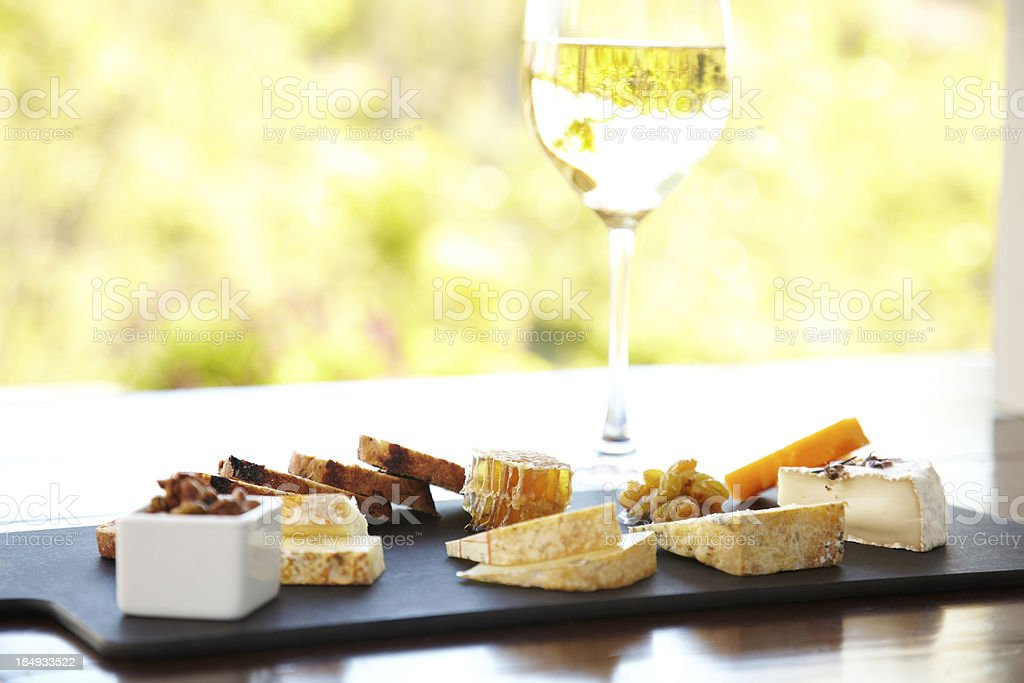 Cheese plate with bread and honey at a luxury resort royalty-free stock photo