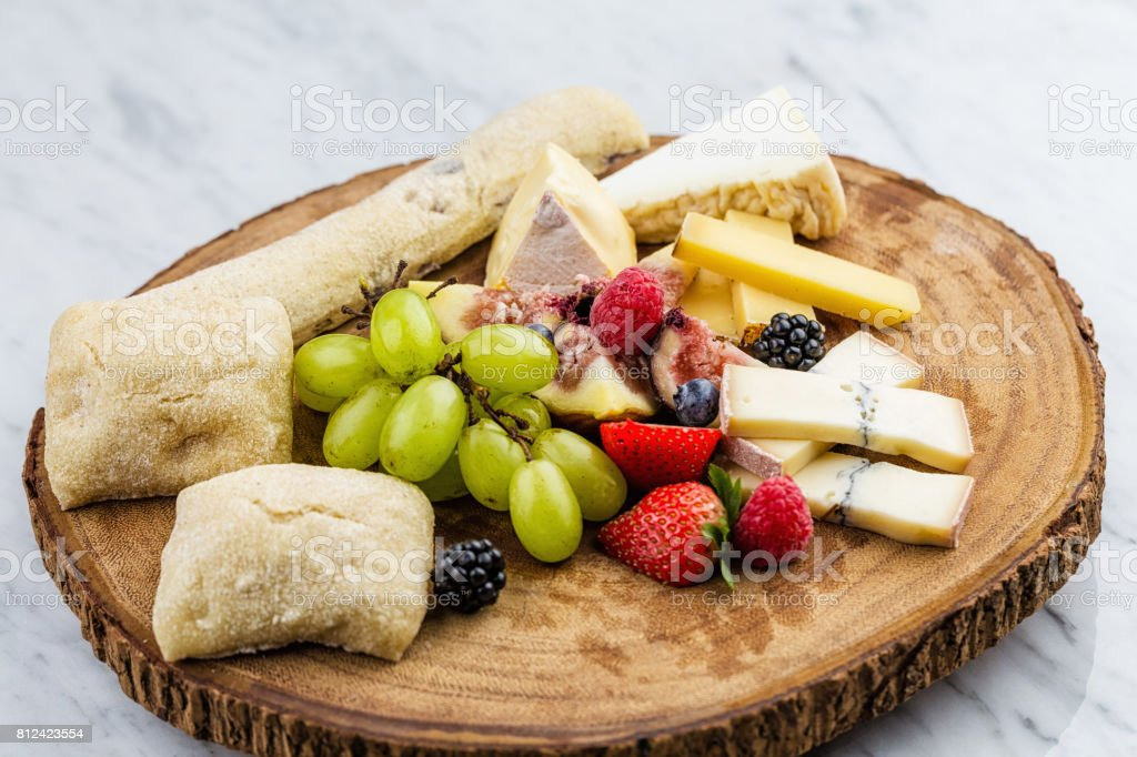 Cheese plate with bread grapes and strawberries royalty-free stock photo & Cheese Plate With Bread Grapes And Strawberries Stock Photo u0026 More ...