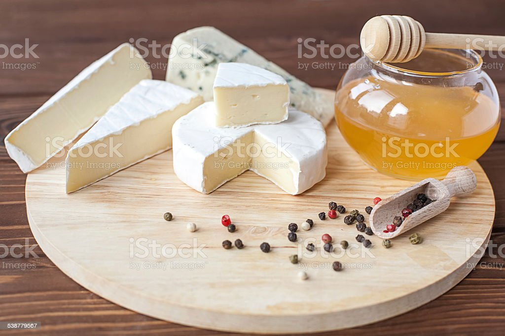 cheese plate with Brie, Camembert, Roquefort stock photo