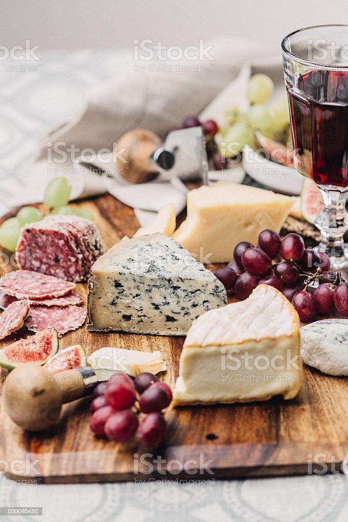 Cheese platter and wine stock photo
