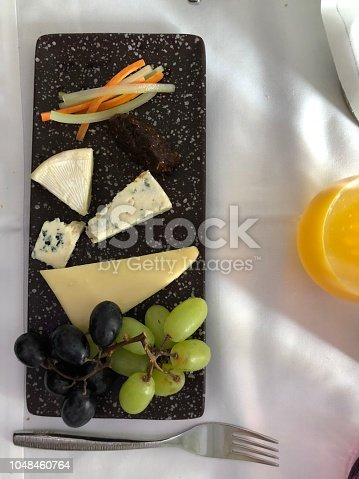 cheese platter, served in business class flight