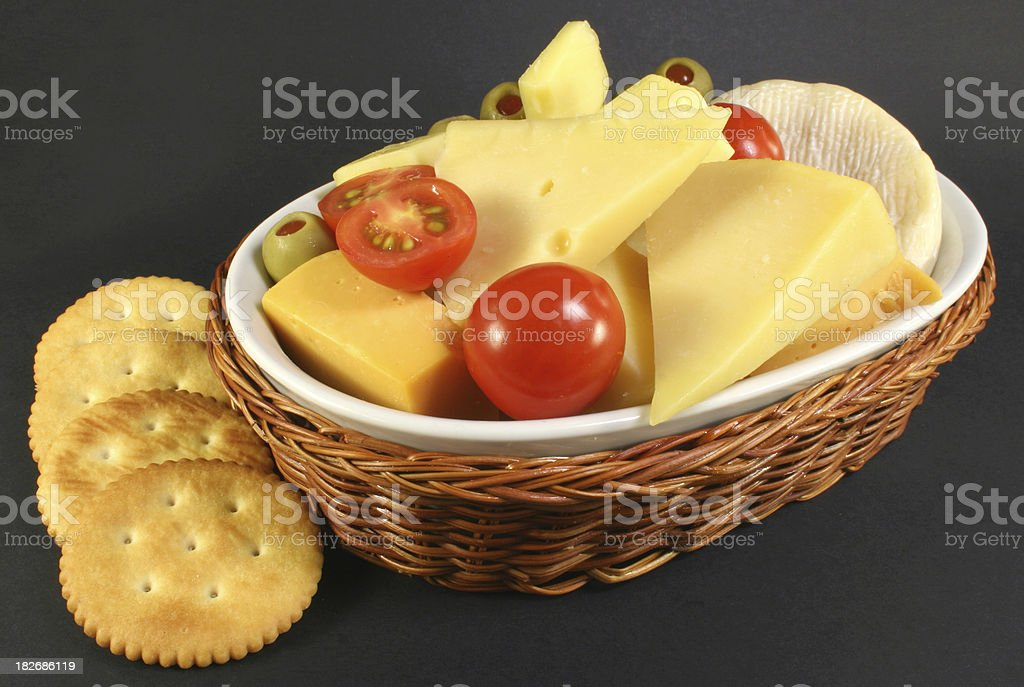 cheese platter with tomato and olives - Royalty-free Antipasto Stock Photo