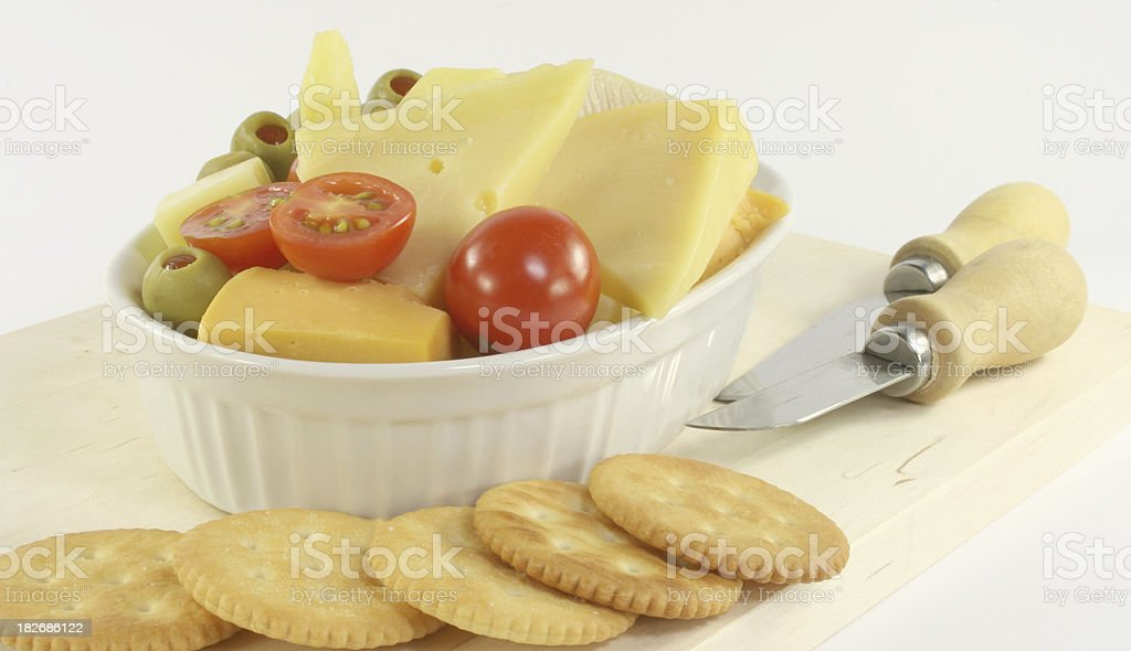 cheese platter with tomato, olives and crackers royalty-free stock photo