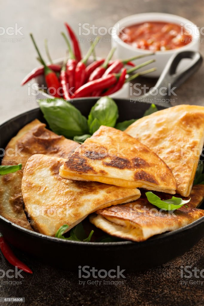 Cheese quesadillas in a cast iron pan royalty-free stock photo