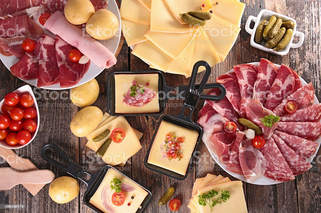 cheese raclette party stock photo