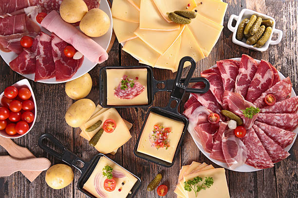 käse-raclette party - raclette stock-fotos und bilder