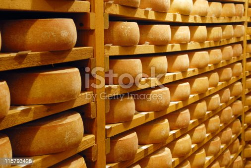 Cheese with raclette in ripening cellar