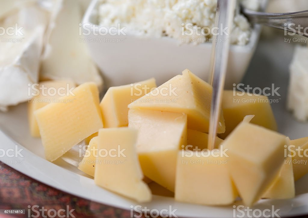Cheese slices on plate close up with copy space photo libre de droits