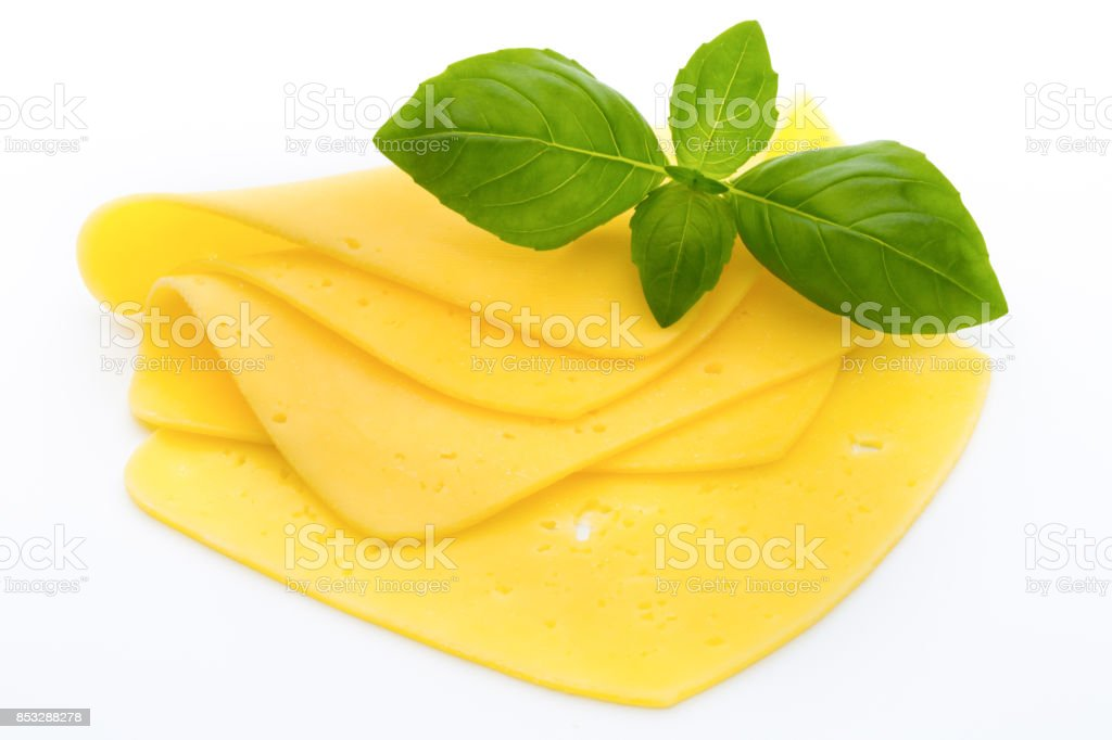 Cheese slices on the white background. stock photo