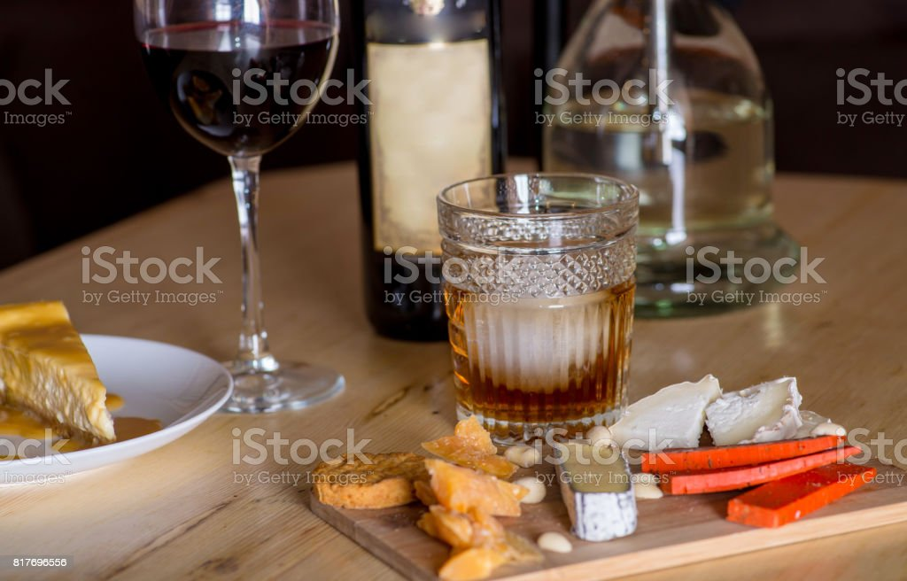 Cheese snacks and alcohol stock photo