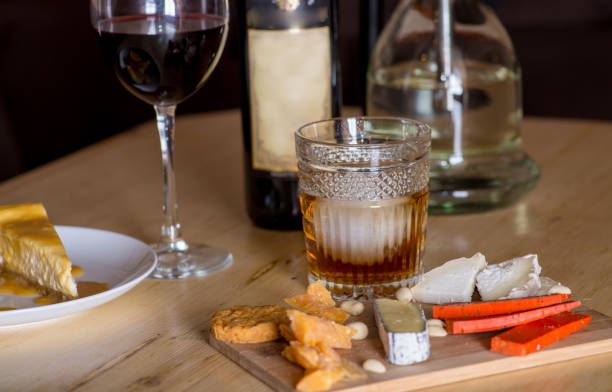 Cheese snacks and alcohol Cheese snacks and alcohol on the table in the restaurant calvados stock pictures, royalty-free photos & images