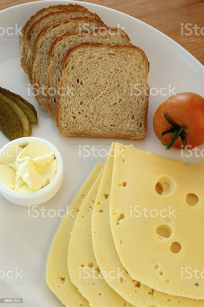 cheese, some bread and tomato on a plate royalty-free stock photo