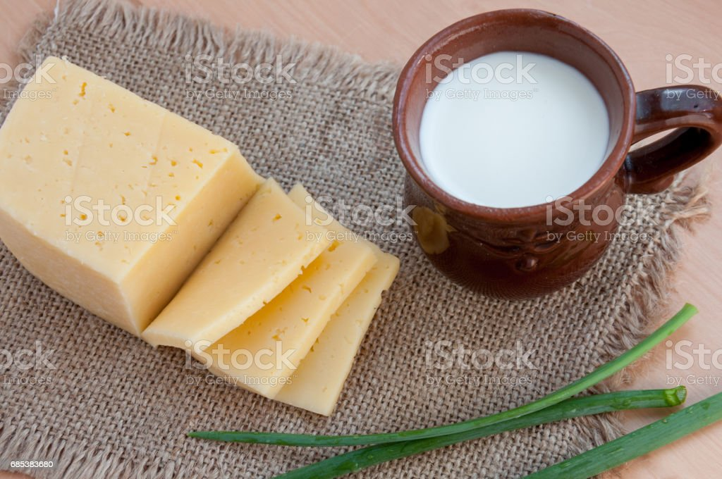 Cheese, spring onion and fresh milk on the table royalty-free stock photo