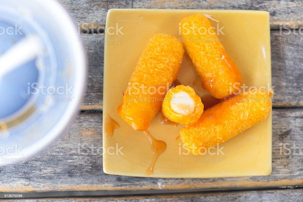 cheese sticks with tomato sauce stock photo