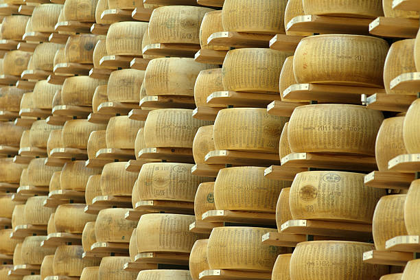 cheese storehouse - parmesan stock photos and pictures