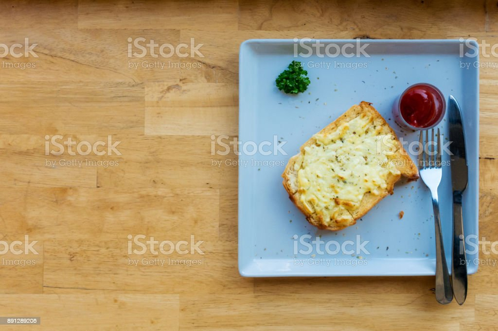 Cheese toast with ketchup serving on table stock photo