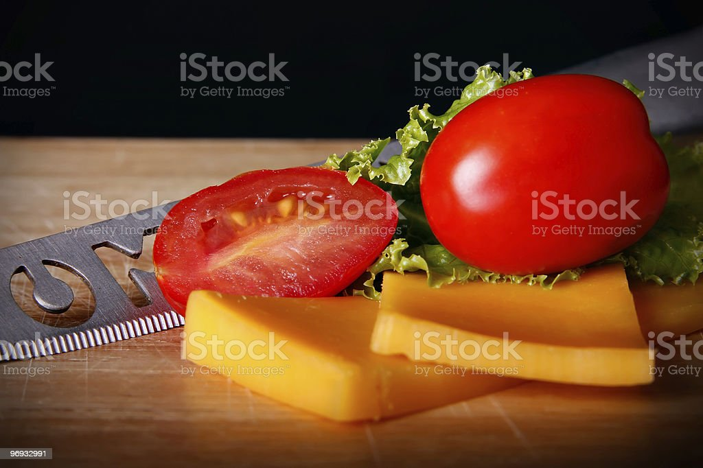 Cheese & Tomatoes on a Bread Board royalty-free stock photo