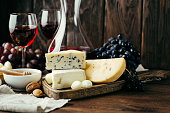 istock Cheese, wine and honey, wooden background, snack, alcohol, dairy products 1041684726