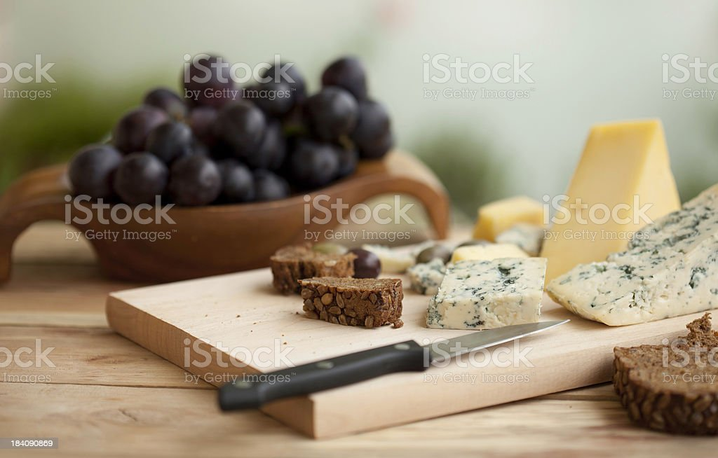 Cheese with bread and grapes royalty-free stock photo