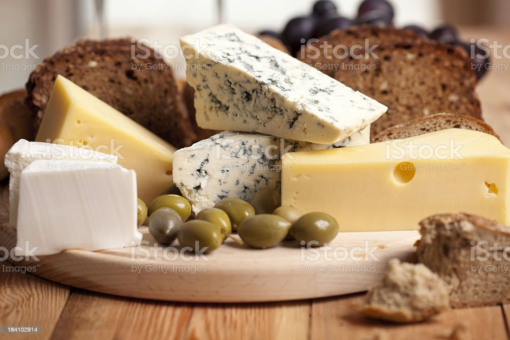 Cheese with bread and olives stock photo
