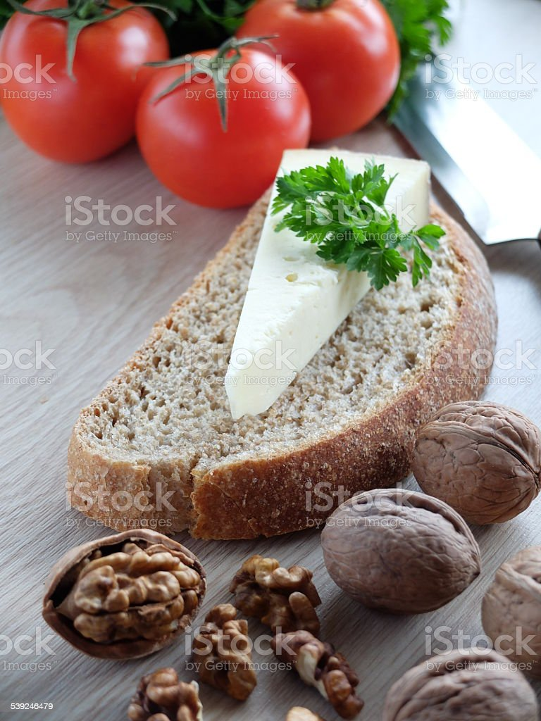 Cheese with brown bread stock photo