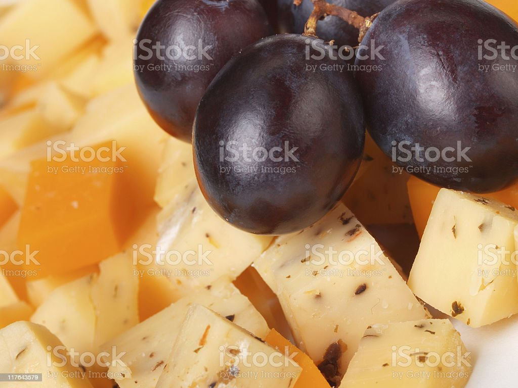 Cheese with grapes royalty-free stock photo