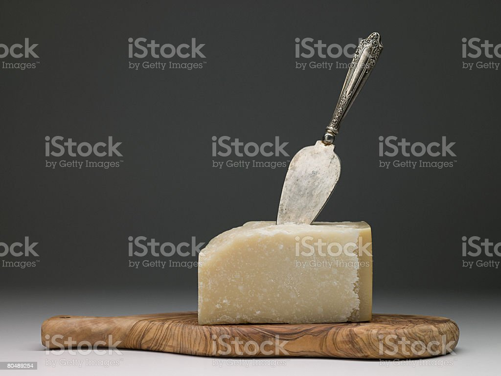 Cheese with knife and board 免版稅 stock photo