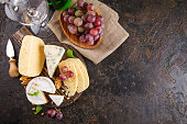 istock Cheese with nuts and grapes 914616464