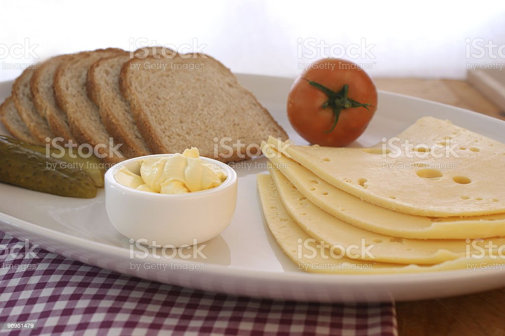 cheese with organic tomato, butter and bread royalty-free stock photo