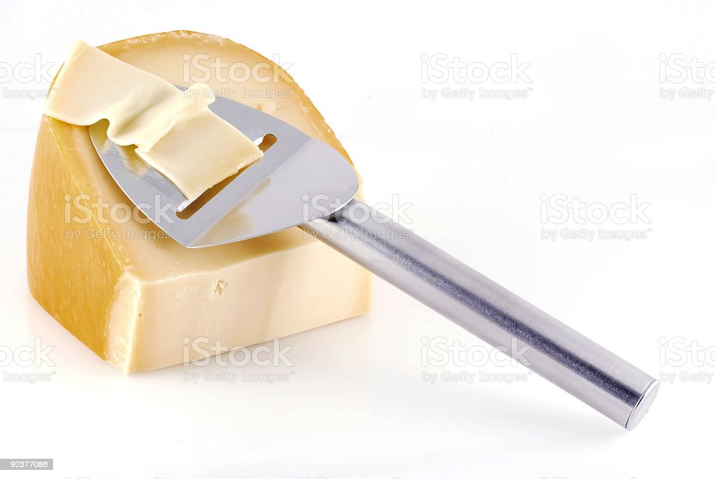 Cheese with slicer. royalty-free stock photo