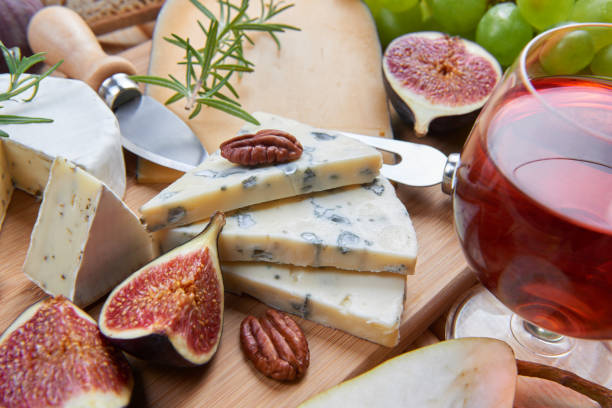 Cheeseboard with blue cheese and fruits stock photo