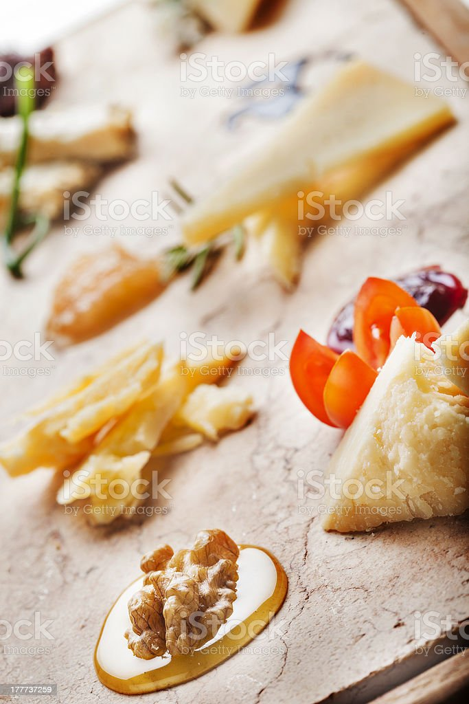 Cheeseboard with italian Cheeses ready for degustation. Gourmet Cheese Course royalty-free stock photo