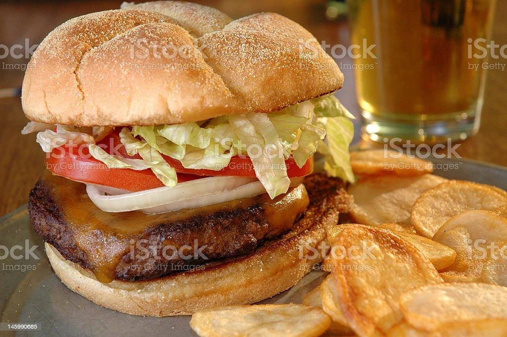 Cheeseburger and chips stock photo