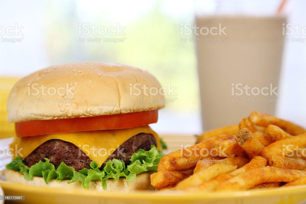Cheeseburger, French Fries, and Shake stock photo