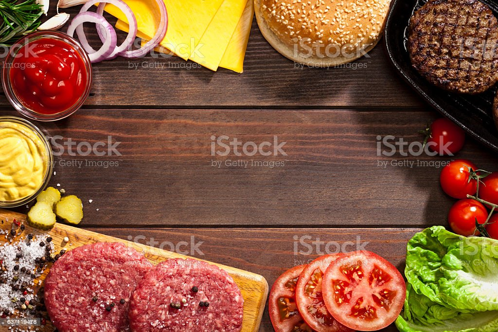 Cheeseburger ingredients frame stock photo