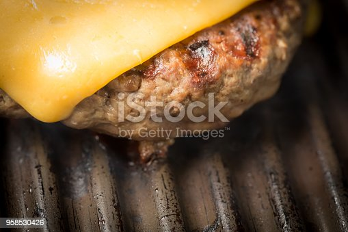 Cheeseburger patty on a grill