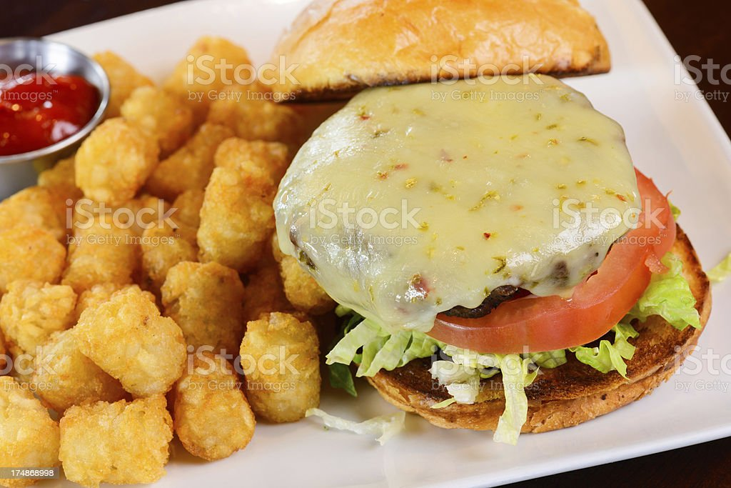 Cheeseburger Served with Tator Tots stock photo