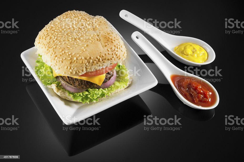 Cheeseburger with tomato sauce and english mustard royalty-free stock photo