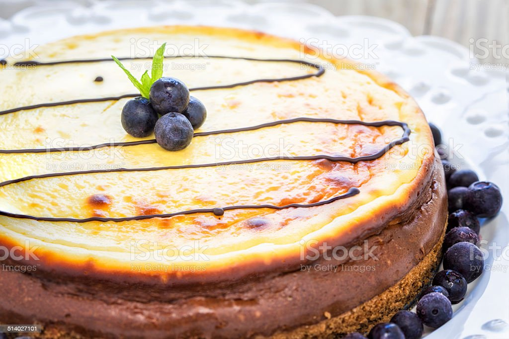 Cheesecake and blueberries stock photo