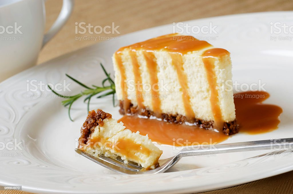 Cheesecake Slice with Caramel Sauce, Bite on Fork stock photo