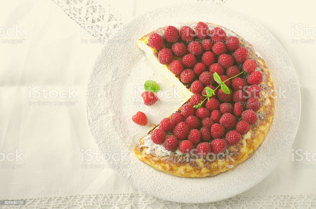 Cheesecake, souffle, cream mousse, pudding dessert with fresh raspberries and